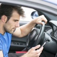 Man-on-his-cell-while-driving