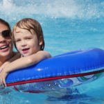 Mother with her son in a pool