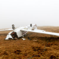 Plane crashes near mountain