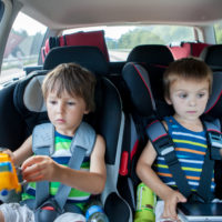Two kids in car seats.jpg.crdownload